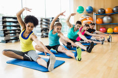 Fitness class exercising in the studio Royalty Free Stock Image