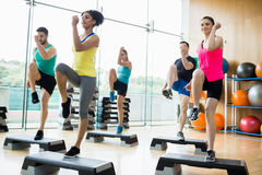 Fitness class exercising in the studio Stock Photography