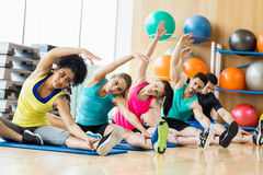 Fitness class exercising in the studio Stock Image