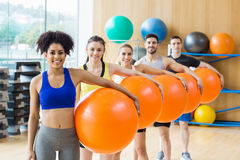 Fitness class exercising in the studio Royalty Free Stock Images