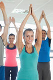 Fitness class with hands joined at exercise studio Stock Image
