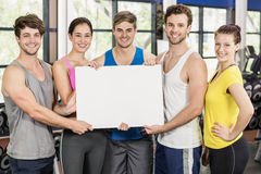 Fitness class holding a white card Royalty Free Stock Photo
