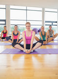 Fitness class and instructor doing the butterfly stretch Royalty Free Stock Photos