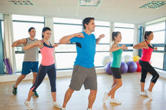 Fitness class and instructor doing pilates exercise Stock Images