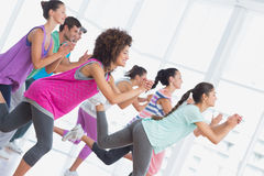 Fitness class and instructor doing pilates exercise Royalty Free Stock Images