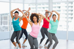 Fitness class and instructor doing pilates exercise Royalty Free Stock Image