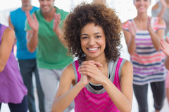 Fitness class and instructor doing pilates exercise stock photos