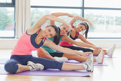 Fitness class and instructor doing stretching pilate exercises Stock Image