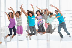 Fitness class jumping in fitness studio Stock Photos