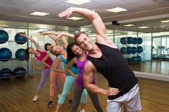 Fitness class led by handsome instructor Stock Image