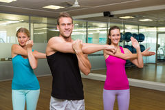 Fitness class led by handsome instructor Stock Photography