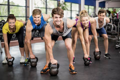 Fitness class lifting dumbbells Stock Image