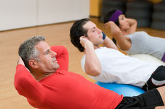 Fitness class making sit-ups Royalty Free Stock Image