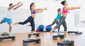 Fitness class performing step aerobics exercise Stock Image