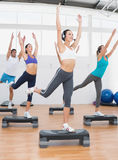 Fitness class performing step aerobics exercise Stock Photos