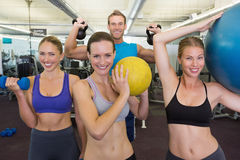 Fitness class posing with different equipment Royalty Free Stock Images