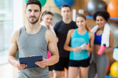 Fitness class smiling at camera in studio Royalty Free Stock Photo