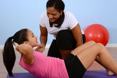 Fitness Class. Teen girl working out in the gym Stock Image