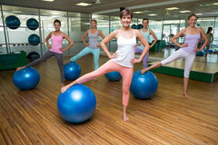 Fitness class using exercise balls in studio Royalty Free Stock Photography