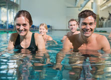 Fitness class using underwater exercise bikes Royalty Free Stock Photos