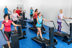 Fitness class walking on treadmill running belt Stock Photography