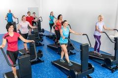 Fitness class walking on treadmill running belt Stock Photography