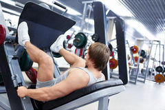 In fitness club. Man is engaged in fitness club Royalty Free Stock Photo