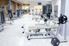 Fitness club gym with sport equipment interior. Fitness club gym with sport equipment modern interior Royalty Free Stock Photos
