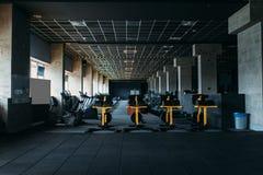 Fitness club interior. Gym nobody. Sport center equipment royalty free stock photo