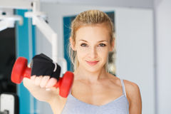 At the fitness club. Young woman doing exercises at the fitness club stock photography