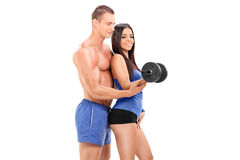 Fitness coach exercising with a female athlete Stock Images