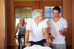 Fitness coach explaining spinning Stock Photo