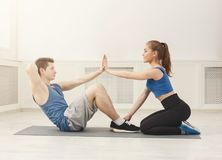 Fitness coach help with doing crunches Stock Image