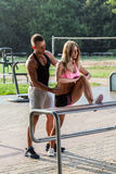 Fitness coach helping attractive woman Stock Photography