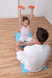 Fitness coach and little girl Royalty Free Stock Photos