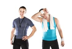 Fitness coach. Professional fitness coach with beautiful young woman on white background Stock Photo