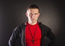 Fitness coach. Professional fitness coach isolated on black background Stock Photos