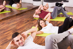 Fitness coach showing new exercise Stock Photo