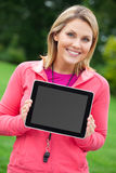 Fitness coach with tablet pc. A fitness coach holding a blank tablet PC Stock Images