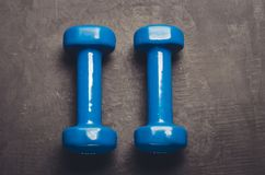 Fitness concept with blue dumbbells/ fitness concept with blue dumbbells and on a dark background. Top view. Fitness concept with blue dumbbells/fitness concept stock images