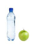 Fitness concept: Bottle with apple (isolated) Royalty Free Stock Photo