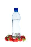 Fitness concept: Bottle with a strawberry Stock Images