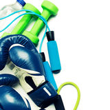 Fitness concept - boxing glove, dumbbells, skipping rope and bottle Royalty Free Stock Image