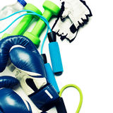 Fitness concept - boxing glove, dumbbells, skipping rope and bottle Royalty Free Stock Images