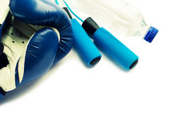 Fitness concept - boxing glove with skipping rope Royalty Free Stock Photography