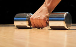 Fitness concept. Closeup of hand holding weight as fitness concept Royalty Free Stock Photos