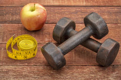 Fitness concept with dumbbells Stock Photos