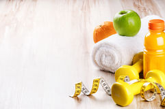 Fitness concept with dumbbells and fresh fruits Stock Photos