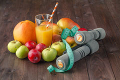 Fitness concept with dumbbells, Fruit, juice Stock Photos