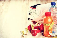 Fitness concept with dumbbells, fruits juice and water bottle Stock Photography